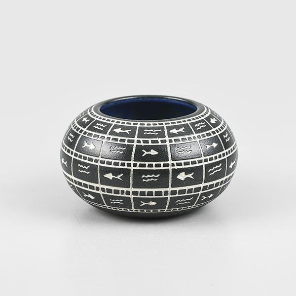 Hand-engraved porcelain bowl with petroglyphs